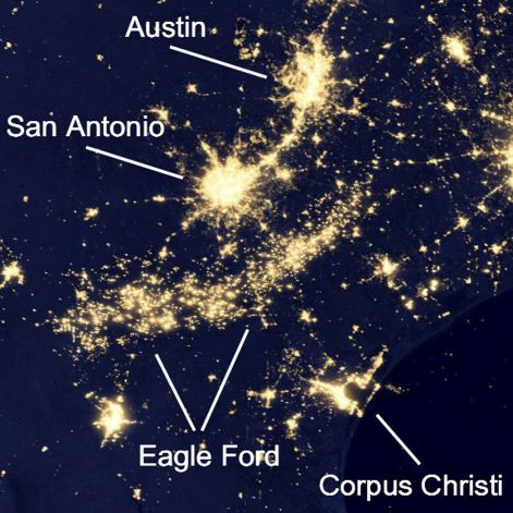 Satellite imagery of the Eagle Ford Shale drilling boom, with lights from hundreds of oil and gas rigs carving a crescent-shaped glow across South Texas.