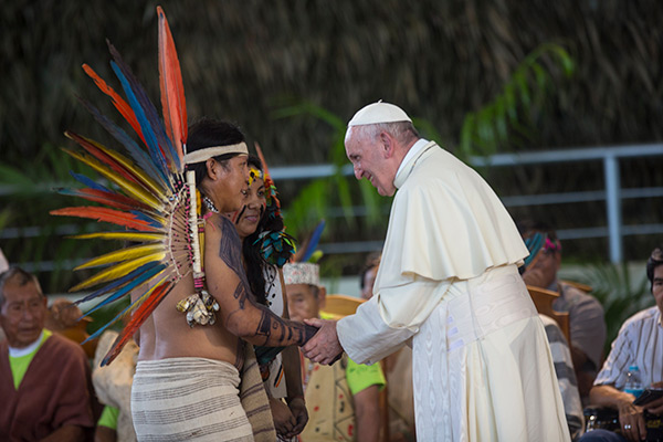 Pope Francis greets indigenous representatives in Puerto Maldonado, Peru, Friday, Jan. 19, 2018