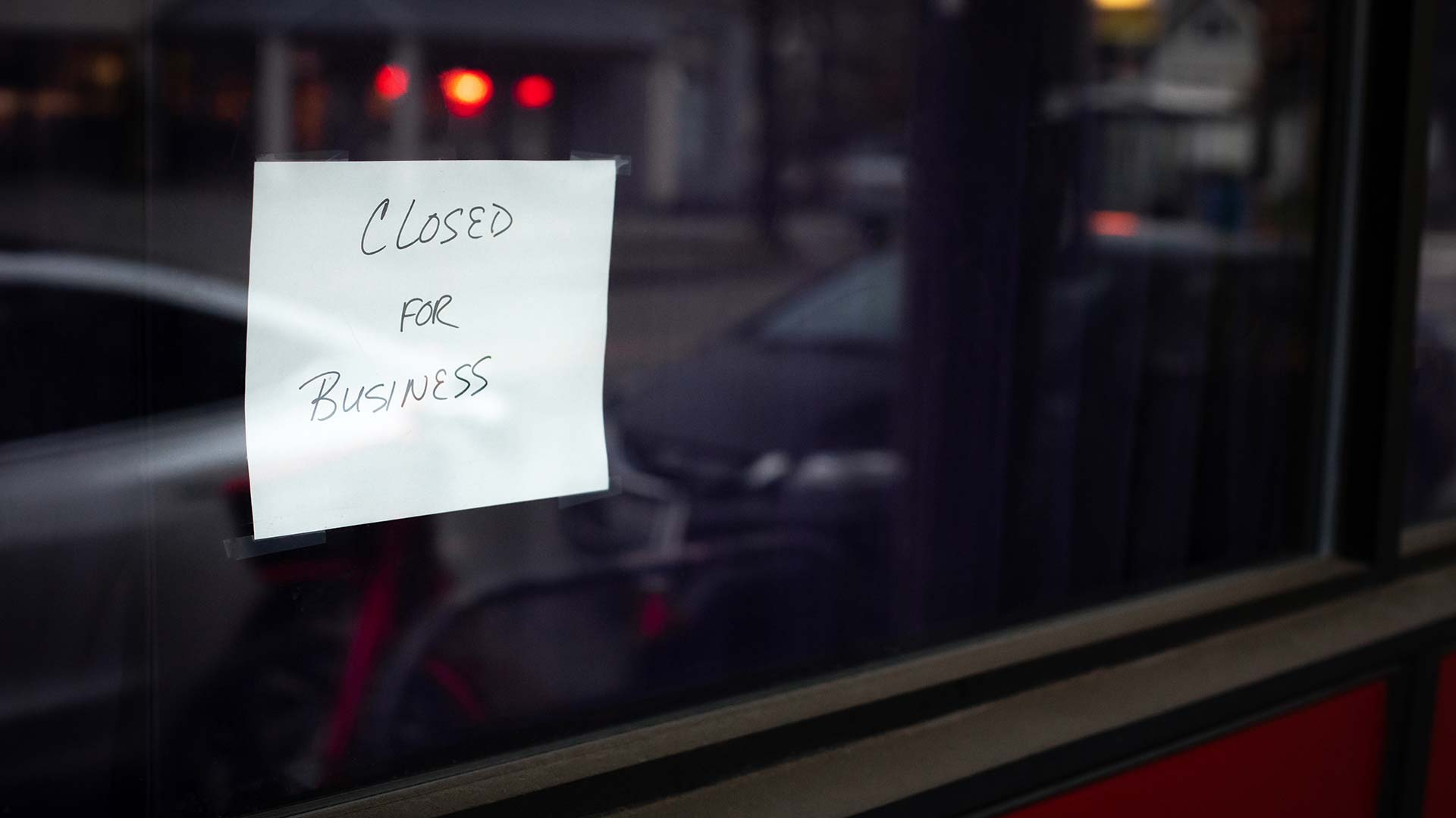 Closed sign on a storefront window