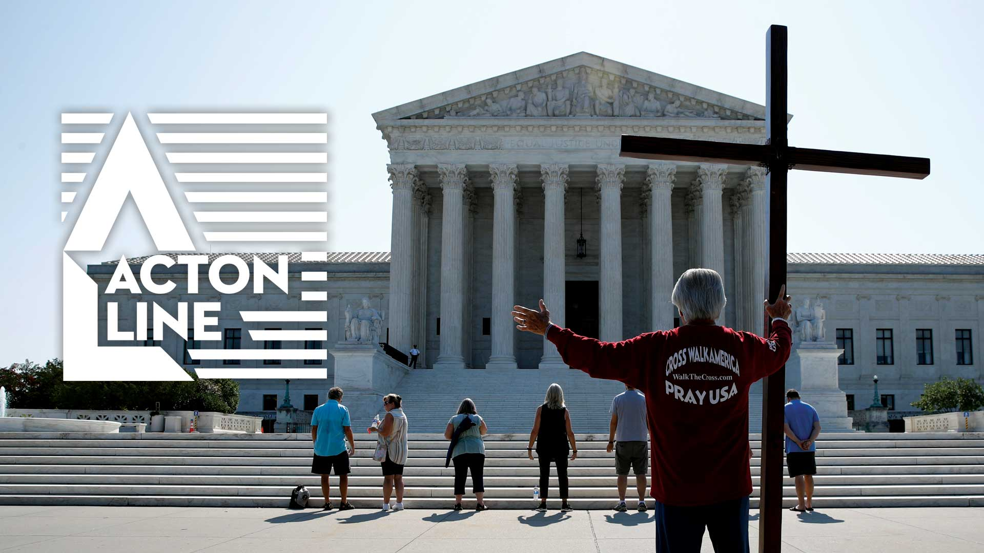 Man praying outside the SCOTUS building